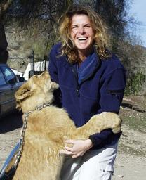 Dr. Jennifer Conrad with a lion cub