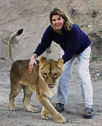 Dr.-Jennifer-Conrad-with-a-lion-standing